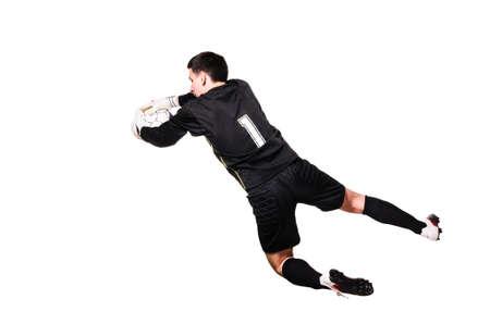 arquero de futbol: portero de fútbol es la captura de una pelota, aislado en fondo blanco