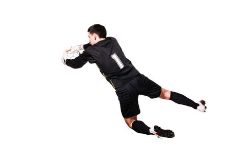 soccer goalkeeper is catching a ball, isolated on white background Reklamní fotografie