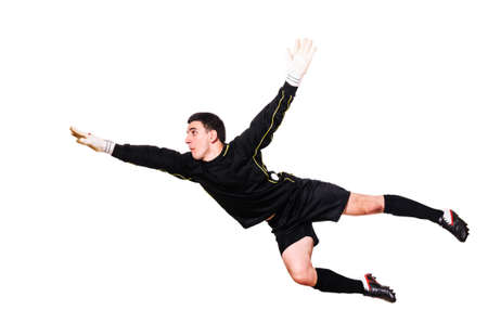 soccer goalkeeper is catching a ball, isolated on white background Standard-Bild