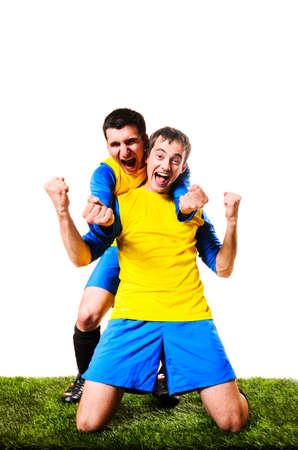 happy football or soccer players are celebrating, isolated on white background photo