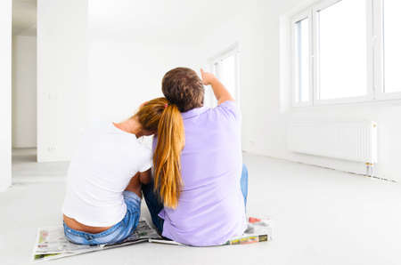couple at their new empty apartment 写真素材