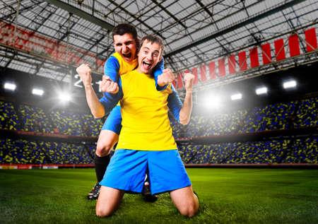축구 또는 축구 선수가 경기장에 목표를 축하하는