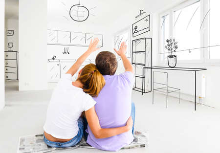 couple at their new empty apartment Banco de Imagens