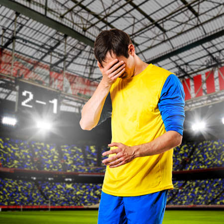 defeat: soccer or football player are celebrating goal on stadium