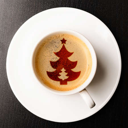 christmas morning: cup of fresh coffee on table, view from above Stock Photo
