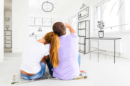 couple at their new empty apartment 版權商用圖片