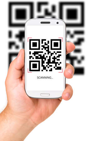 cut out device: male hand is holding a modern touch screen phone and scanning QR code