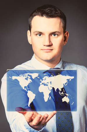 caucasian businessman is holding world map in hands photo