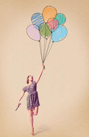 flying woman: imagination  young woman is flying away with drawn balloons