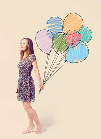 imagination  young woman is standing with drawn balloons photo