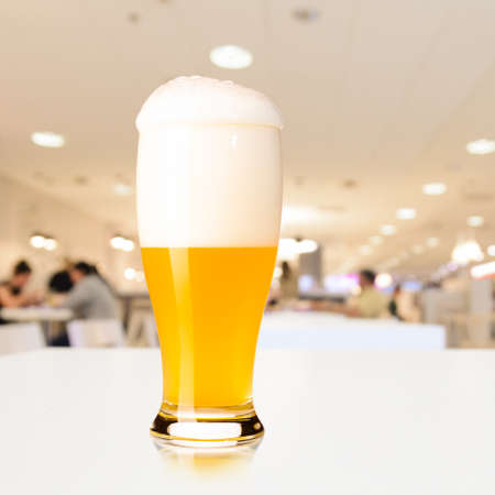 unfiltered: glass of fresh draft unfiltered beer on table in cafe Stock Photo