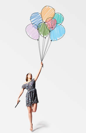 balloon woman: imagination  young woman is flying away with drawn balloons