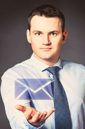 caucasian businessman is holding message in hands photo