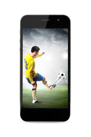 modern phone with soccer or football player shooting a ball on screen photo