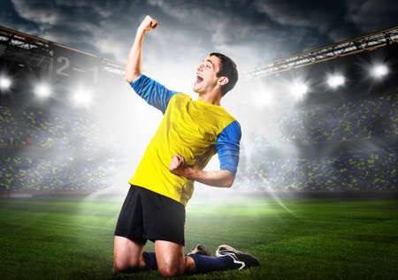 soccer or football player is celebrating goal on stadium Stock Photo