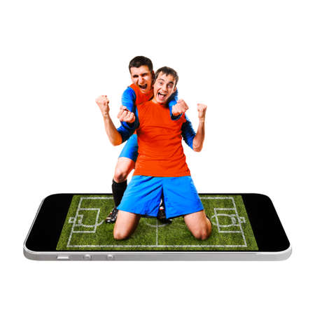 soccer or football player is celebrating on screen of modern phone photo