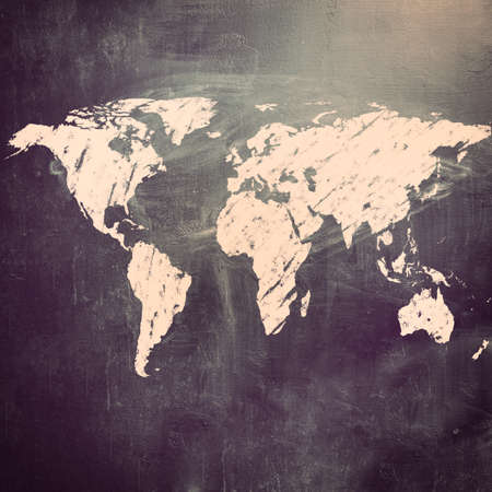 world map on chalk board. Earth silhouette  photo
