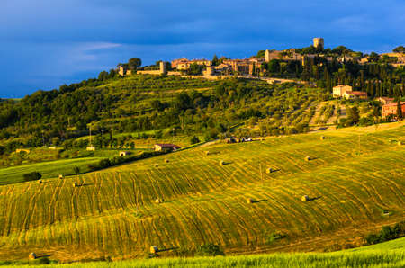 siena italy: sunset view of Monticchiello, province of Siena, Val dOrcia in Tuscany, Italy