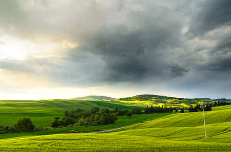 foggy hill: sunset view of Pienza, province of Siena, Val dOrcia in Tuscany, Italy
