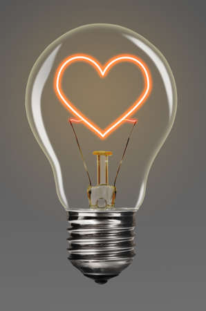 bulb with glowing red heart inside of it, creativity concept photo