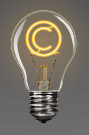 property rights: bulb with glowing copyright sign inside of it, creativity concept