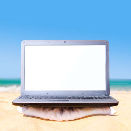 downshifting: laptop on beach ready for remote work or freelance Stock Photo