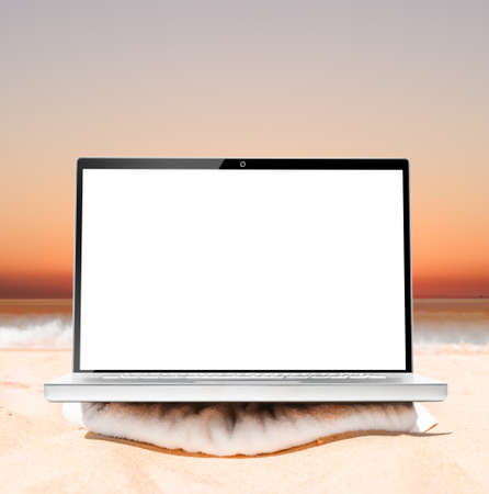 downshifting: laptop on beach at sunrise ready for remote work or freelance Stock Photo
