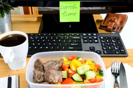 lunch: homemade lunch box at modern stylish work place, view from above