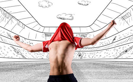soccer or football player is celebrating goal on drawn stadium with his jersey on head photo