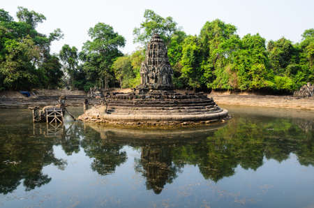 place of worship: Neak Pean, part of Khmer Angkor temple complex, popular among tourists ancient landmark and place of worship in Southeast Asia. Siem Reap, Cambodia. Stock Photo