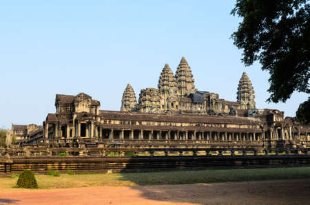 khmer: Angkor Wat, part of Khmer temple complex, popular among tourists ancient landmark and place of worship in Southeast Asia. Siem Reap, Cambodia. Stock Photo