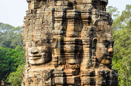 khmer: Prasat Bayon, part of Angkor Khmer temple complex, popular among tourists ancient landmark and place of worship in Southeast Asia. Siem Reap, Cambodia. Stock Photo
