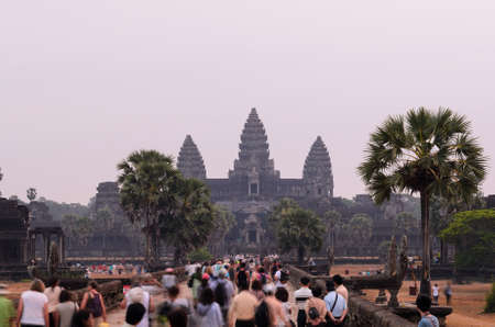 khmer: Sunrise at Angkor Wat, part of Khmer temple complex, popular among tourists ancient landmark and place of worship in Southeast Asia. Siem Reap, Cambodia. Stock Photo