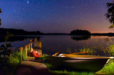 serene starry night on the coast of Finnish lake Stock Photo