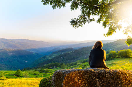 woman sunset: scenic view of woman watching at sunset mountains, Peneda-Geres National Park, northern Portugal.