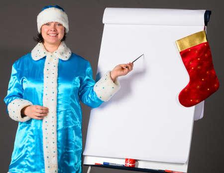 'snow maiden': Snow Maiden is pointing on flip chart