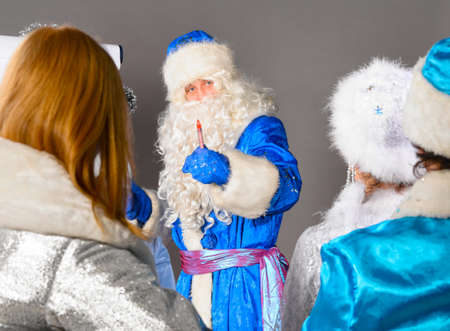 conducting: santa claus is conducting a business training Stock Photo