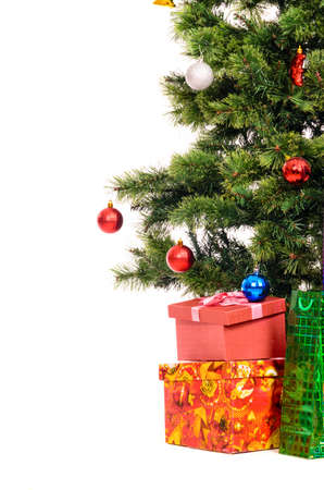 white christmas tree: decorated christmas tree with gifts cut out from white background Stock Photo