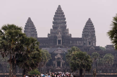 Angkor Wat, part of Khmer temple complex, popular among tourists ancient landmark and place of worship in Southeast Asia. Siem Reap, Cambodia. Stock Photo