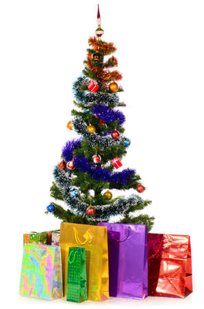 decorated christmas tree: decorated christmas tree with gifts cut out from white background Stock Photo