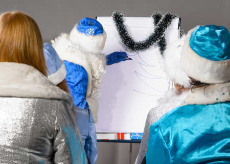 santa claus is conducting a business training photo