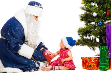 baby near christmas tree: baby and santa claus near christmas tree with gifts Stock Photo
