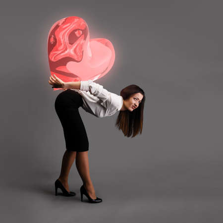 bending over: Woman is bending over under heavy heart symbol