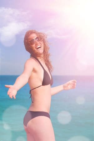 inviting: beautiful woman is inviting you to the sea Stock Photo