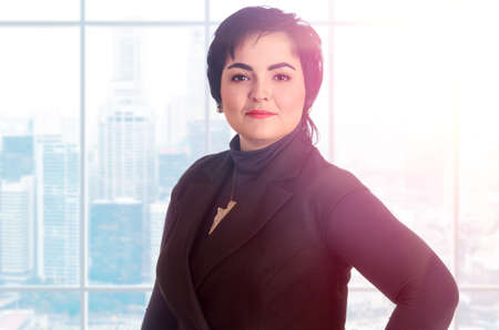 corporate women: Portrait of a happy senior business woman at office
