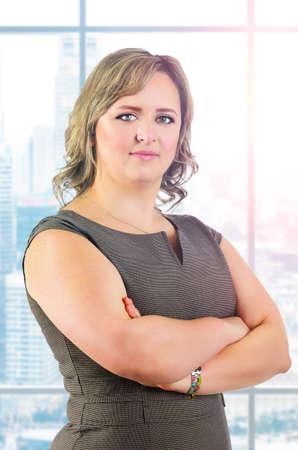plus sized: young caucasian plus sized business woman portrait