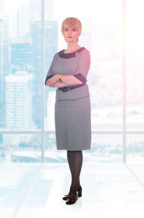 pretty dress: Portrait of a happy senior business woman at office
