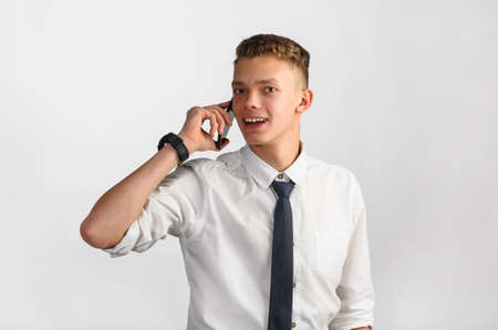 horizontal haircut: portrait of young stylish businessman on gray background