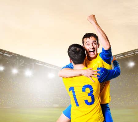 jugadores de futbol: soccer or football players are celebrating goal on stadium