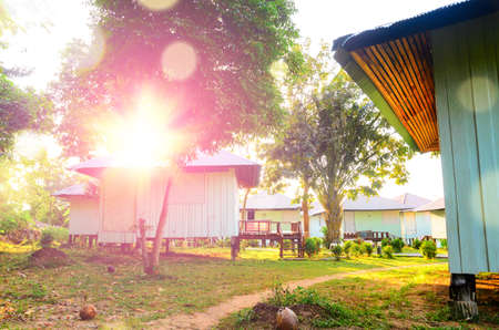 phi phi: morning sun and houses on stilts with lens flare at Phi Phi, Thailand Stock Photo